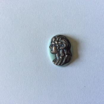 Metal head on stone