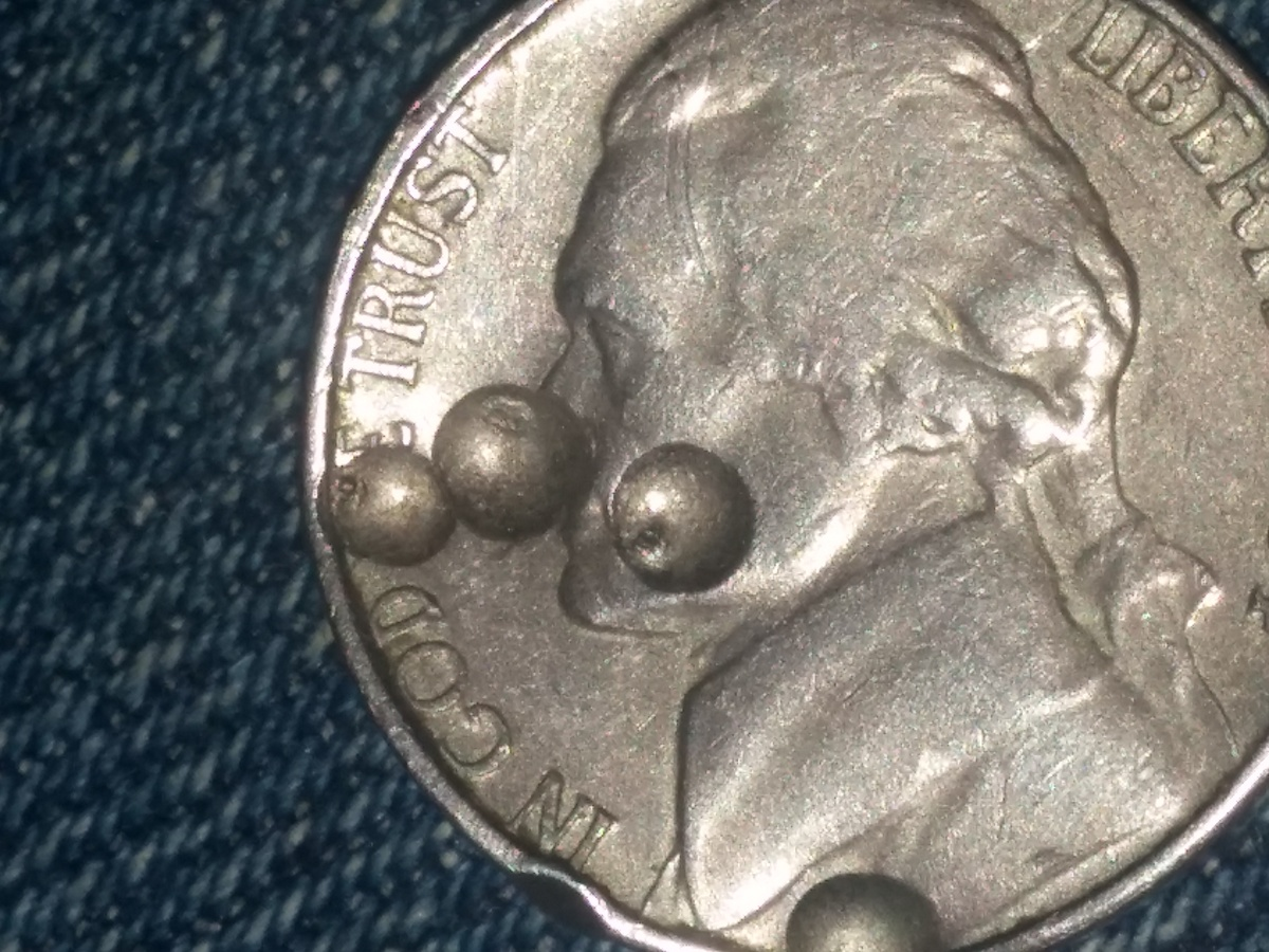 1964 Jefferson Nickel mint error (indentation) | Collectors Weekly