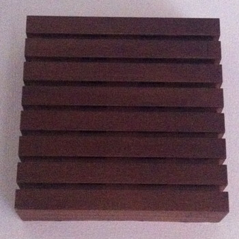 Teak cover for a doorbell.