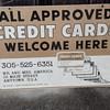 metal credit card sign
