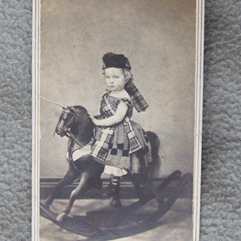 Boy in dress on a rocking horse! - Photographs