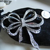 Elegant Silver and Rhinestone BOW pin