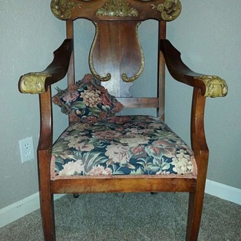 Neat chair with gothic carvings on armrest