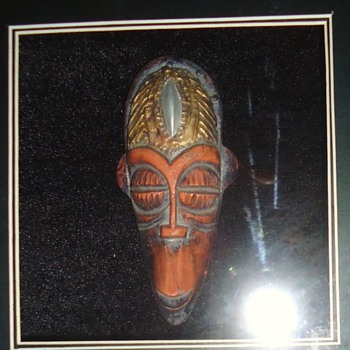 Three  wood framed and carved with wood heads inside? well matted with glass fronts? - Folk Art