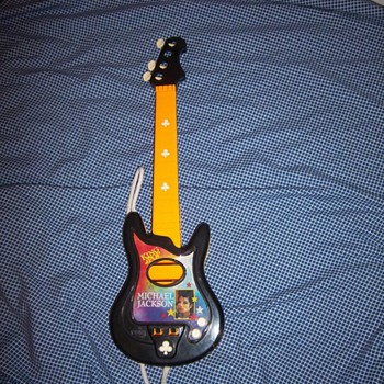 Michael Jackson toy guitar