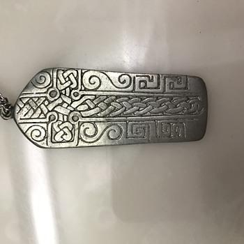 Cross pendant with strange writing