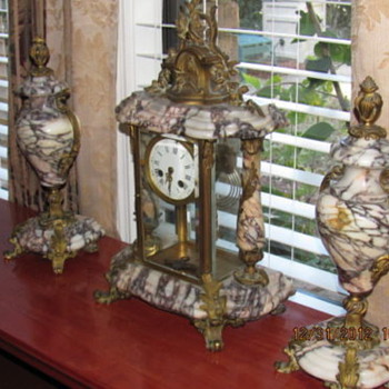 1889 French Bronze mounted marble clock with 2 Cossollettes