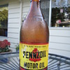 Amber glass bottle Pennzoil 10 weight oil .    1 quart