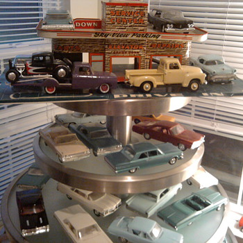 Yard sale table holds Promo Cars well!