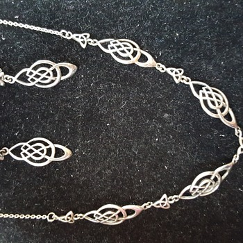 Help! Is this a silver or platinum necklace set? - Fine Jewelry