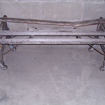 Wooden bench with metal wheels. - Furniture