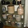 Stoneware crocks on an early bucket bench