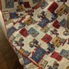 Old handcrafted quilted blanket.