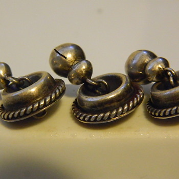 "My favorite silver buttons 1930s Mexico, paper weights, Pacific Northwest carved wood canoe 8"", Galle lamp shade."