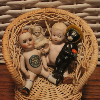 A Wellspring of Bisque upon Wicker - Dolls