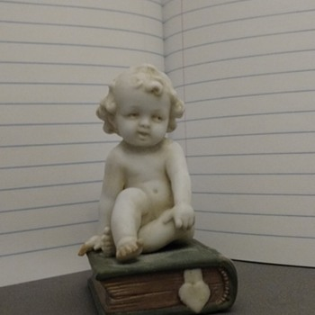 Child on book and Toddler and cat on a stool Figurines