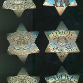 "A group of railroad police ""pie plate"" badges used in Chicago during the 1920's"