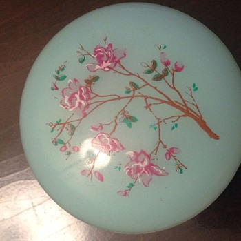 round blue hinged trinket box with floral print