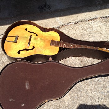 Guitar left to us & have had it for years.  Is it worth anything or just a design item? - Guitars