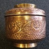 Ornate copper pot with lid