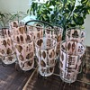 Set of 8 mid-century glasses with caddy