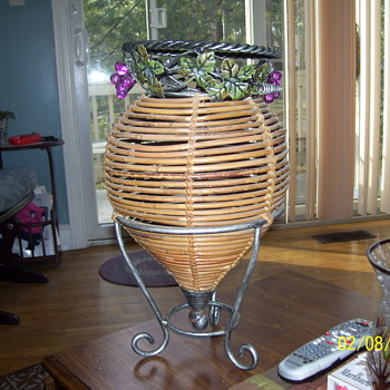 pewter round thing with bamboo