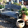 Very old and elaborate garden bench and chairs