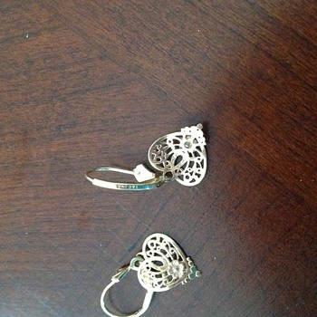 ? If anyone know about 14kt T and C Heart Earrings.  What is it? - Fine Jewelry