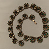 vintage Trifari (Patent Pending) four-leaf clover motif necklace with tiny green rhinestones, collar length