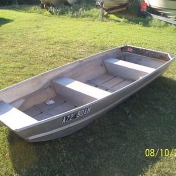 One flat bottom Boat and 2 motors...