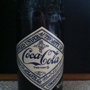 The Atlanta GA, Coca-Cola 75th Anniversary Bottle (10 FL. Oz).