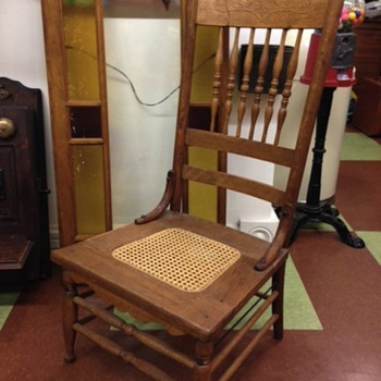 Very low Victorian, oak, pressed-back chair.