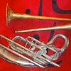 two trombone bells and 1/3 of a sousaphone