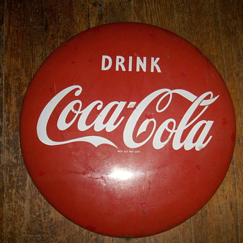 Coca-cola button sign