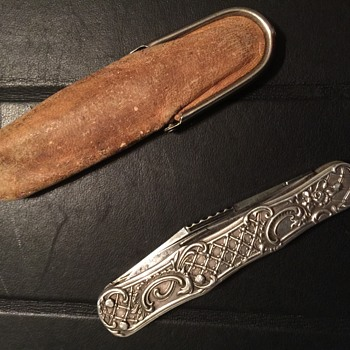 Antique sterling silver pocket knife.