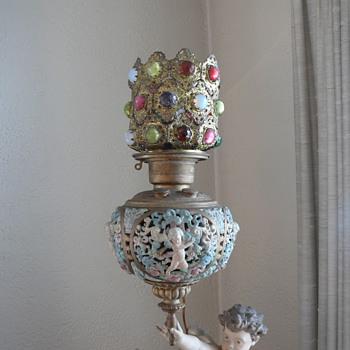 "Figural kerosene lamp, label: Love's Victory"". - Lamps"
