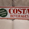 Costa Beverages tin tacker sign.
