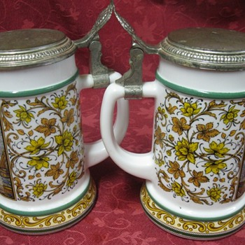 two german beer drinking mugs