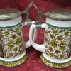 two german beer drinking mugs