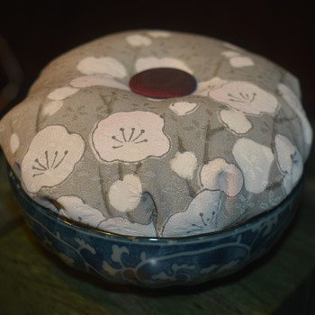 What is this piece?  Beautiful little silk cushion with a button inside a small Japanese Bowl - Asian