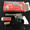 Buck Toy cap gun with original box and roll of caps