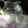 Depression glass pitcher and drinking glass.