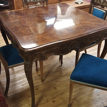 Antique burl table, chairs with mother of pearl