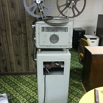 Bell and Howell 16 mm movie projector  - Cameras