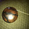 A wooden Yo Yo but we have no idea who made this...