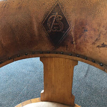 Trying to identify logo on back of chair