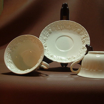 wedgewood embossed queensware  with pattern inside cups
