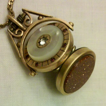 Spinning Watch Fob Locket w/Mother of Pearl, Rubies, and Sandstone.