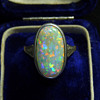 An Art Deco 9ct Gold Ring with a Large Coober Pedy Opal