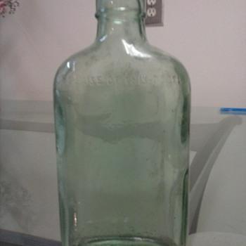 this aqua green flange lip liquor bottle